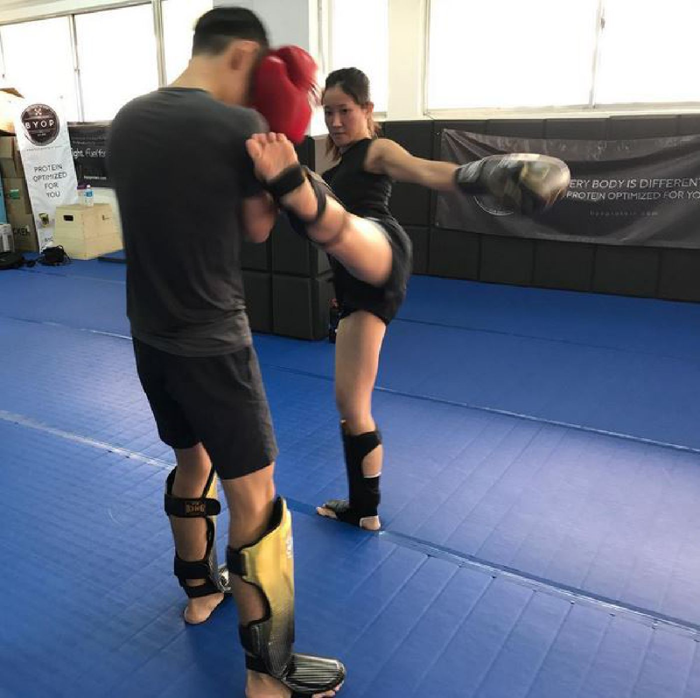Muay Thai Singapore West students practicing their high kicks